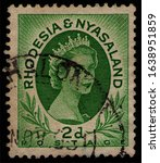 Small photo of RHODESIA AND NYASALAND - CIRCA 1954: post stamp 2 Southern Rhodesian Penny printed by Central African Federation of Rhodesia and Nyasaland, shows British Queen's Elizabeth II portrait, circa 1954