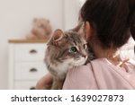 Little Girl With Cute Cat At...