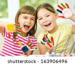 little girls are painting with... | Shutterstock . vector #163906496