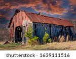 An Old Barn With A Rusty Roof...
