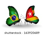 two butterflies with flags on... | Shutterstock . vector #163920689