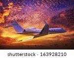 private jet cruising in a... | Shutterstock . vector #163928210