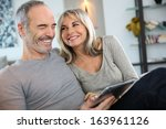 mature couple at home... | Shutterstock . vector #163961126