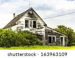 An Old Abandoned House On A...