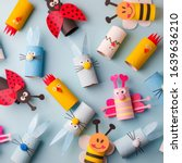 Small photo of Happy easter kindergarten decoration concept - rabbit, chicken, egg, bee from toilet paper roll tube. Simple diy creative idea. Eco-friendly reuse recycle decor, daycare paper craft