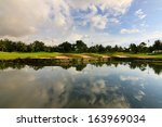 reflection of sky at a golf... | Shutterstock . vector #163969034