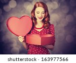 Stock photo redhead girl with gift for valentines day photo with bokeh at background 163977566