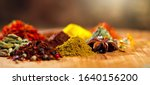 Small photo of Spices. Various Indian Spices colorful background. Spice and herbs backdrop. Assortment of Seasonings, condiments. Cooking ingredients, flavor