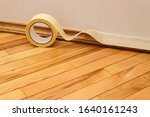sticking masking tape to the...   Shutterstock . vector #1640161243