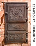 Wrought Iron Door Of The Stove...