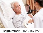 asian old man lying in bed... | Shutterstock . vector #1640487499