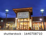 Small photo of Beaverton, Oregon/USA- February 2, 2020: Powell's bookstore in Beaverton, Oregon at twilight