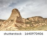 Pawnee Buttes is a preserved section of grassland in the northeastern portion of Colorado.  Arid and dry, it resembles a desert but is home to a large number of mammals, reptiles and predatory birds.