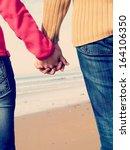 lovers couple holding hands  | Shutterstock . vector #164106350