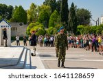 Small photo of Athens,Greece-April 25,2018.Presidential guards pay tribute to the Tomb of Unknown Soldier at Syntagma square while tourists observing and taking photos of the act.