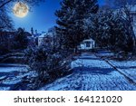 City Park with snowy fir trees and benches, can be seen the dome - stock photo