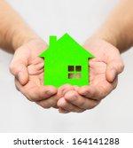 hands hold green house | Shutterstock . vector #164141288