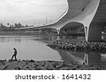 a man walking under a bridge at ... | Shutterstock . vector #1641432
