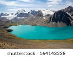 mountain turquoise lake in... | Shutterstock . vector #164143238
