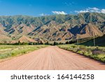 wide country road in tien shan... | Shutterstock . vector #164144258