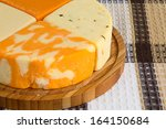 four pieces of cheese on a... | Shutterstock . vector #164150684