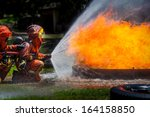Firefighter Fighting For A Fire ...