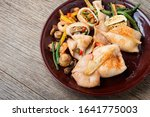 Small photo of Squid stuffed with mushrooms, carrots and peppers.Fried squids or octopus