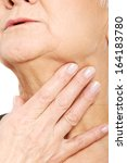 close up on older woman's hand... | Shutterstock . vector #164183780