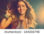 smiling young girl dancing in... | Shutterstock . vector #164206748
