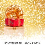 gift box in gold wrapping paper ... | Shutterstock . vector #164214248