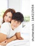 young man carrying girlfriend... | Shutterstock . vector #164215454