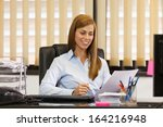 photo of female manager working ... | Shutterstock . vector #164216948