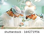 surgeon perform operation on a... | Shutterstock . vector #164271956