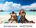 couple on a tropical beach at... | Shutterstock . vector #164276246