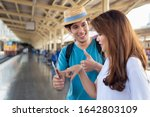 Small photo of Asian woman speaking fluent foreign language with foreigner; concept of communication with foreign language, foreign tourist or caucasian traveler, language learning, language education training