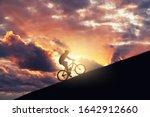 Riding Mountain Bike On A Ramp...