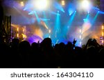 cheering crowd in front of... | Shutterstock . vector #164304110