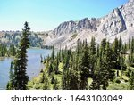 Medicine Bow National Forest in Wyoming, United States. Medicine Bow Peak as seen from Lewis Lake. Located off the Snowy Range Scenic Byway, managed by the Laramie Ranger District.