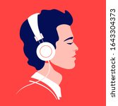young man listen to music on... | Shutterstock .eps vector #1643304373