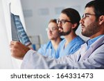 Stock photo portrait of young male doctors looking at x ray 164331473