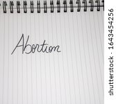 abortion handwriting  text on...   Shutterstock . vector #1643454256