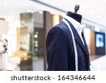 suits on shop mannequins | Shutterstock . vector #164346644