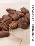 coffee beans on wood background | Shutterstock . vector #164349266
