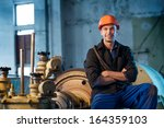 Portrait Of A Worker In The...