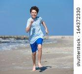 Teenage Boy Running  Jumping O...