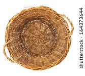 Brown wicker basket isolated over white background, top view - stock photo
