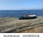 Wooden blue rowboat on the...