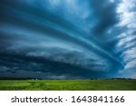 Storm clouds with shelf cloud and intense rain - stock photo