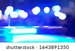 Flashing lights of a police flasher on the roof of a police car at night - stock photo