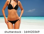 sexy woman body on the beach... | Shutterstock . vector #164420369